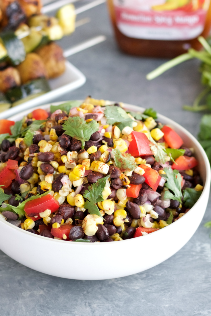 This grilled sweet corn and black bean salad is the perfect combination of sweetness, spiciness and acidity all in one bite. It\'s an ideal summer side dish!