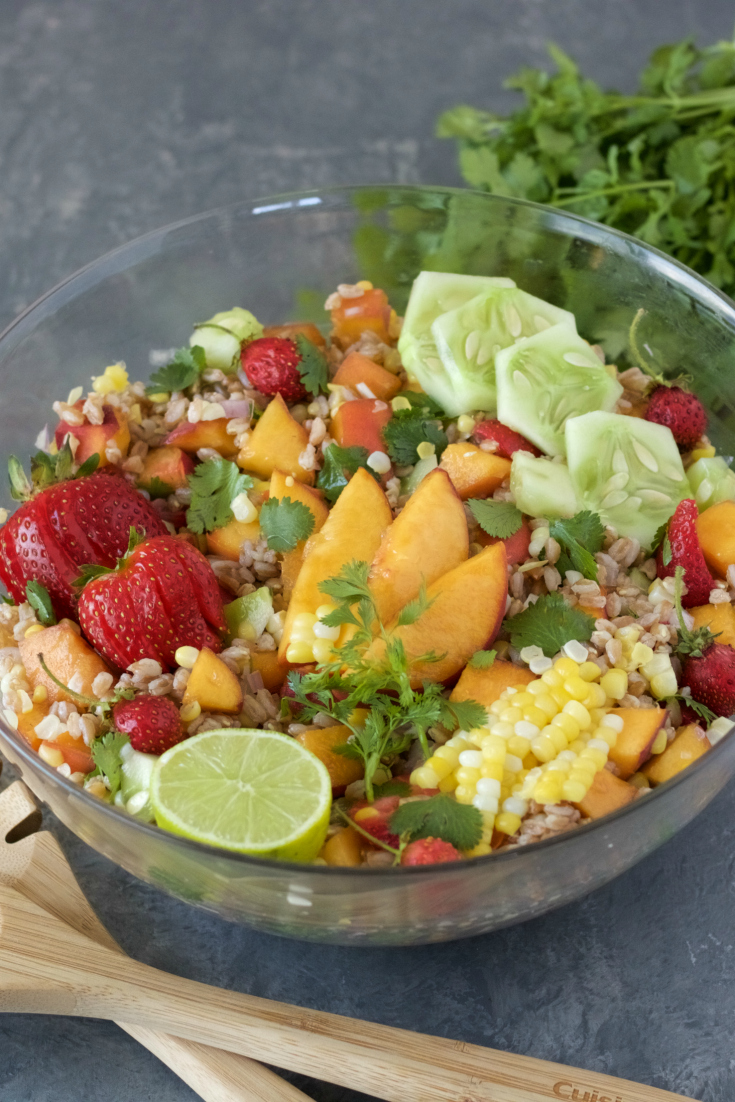This Peach Cilantro Farro Salad is the perfect good-bye summer salad. It\'s filled with all the late summer produce of peaches, strawberries, cucumber and sweet corn. Then it\'s topped off with a honey-lime vinaigrette.
