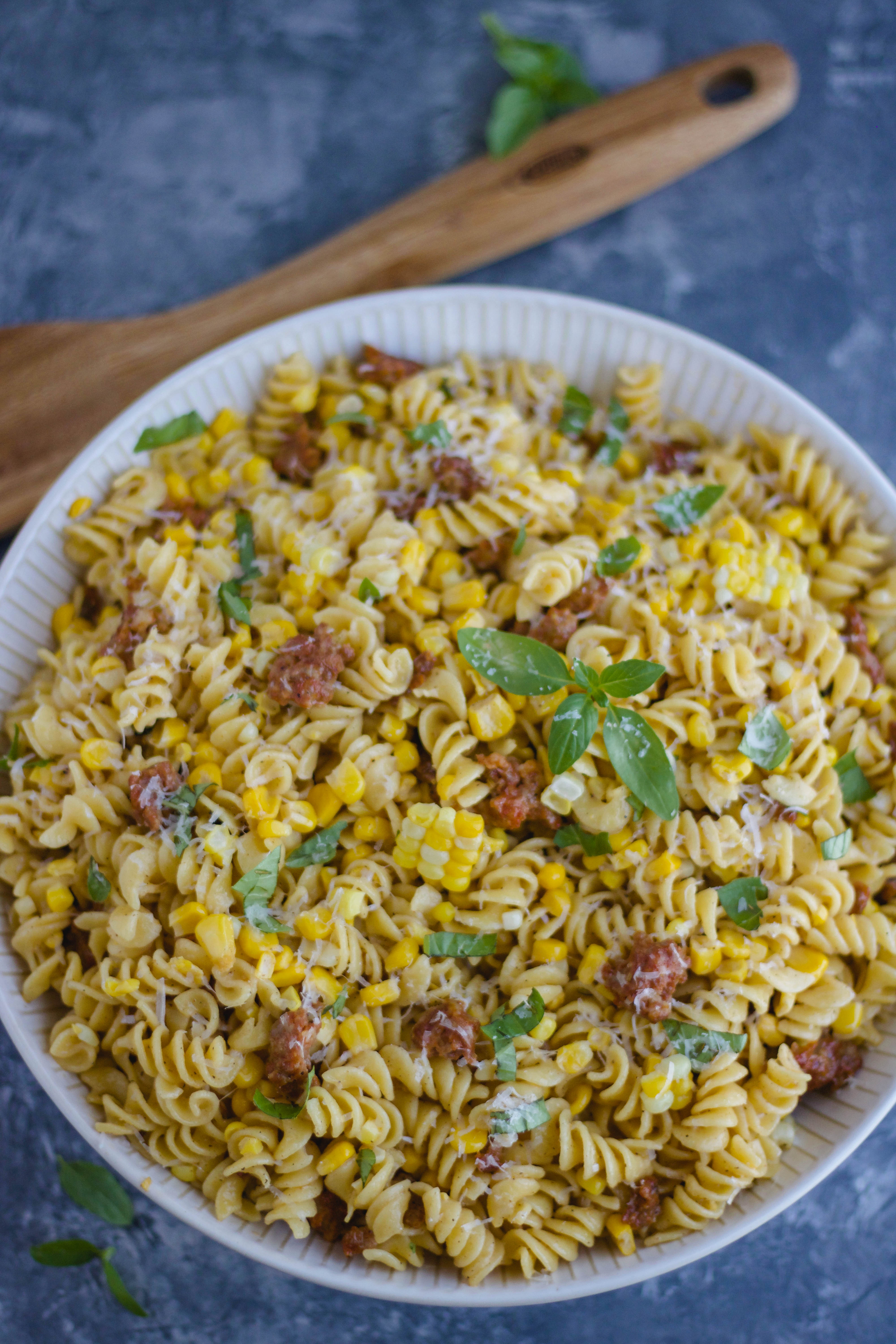 Creamy Rotini Pasta with Sweet Corn and Sausage! Made with simple ingredients like in-season sweet corn, flavorful sausage and fresh basil. This dish is an easy weeknight meal that the whole family will love. It\'s simple and quick and comes together in under 30 minutes.
